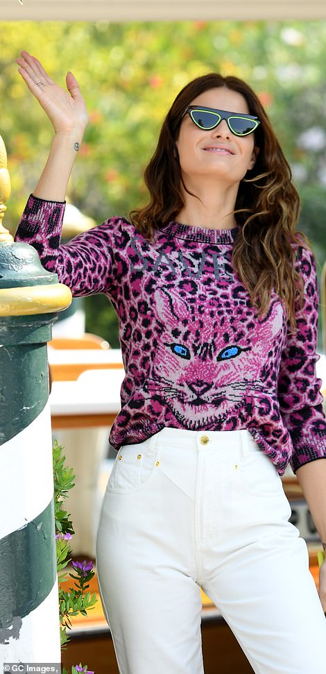 Wow-factor! Isabeli Fontana also looked thrilled as she stepped out into a sunshine with a purple animal print top.