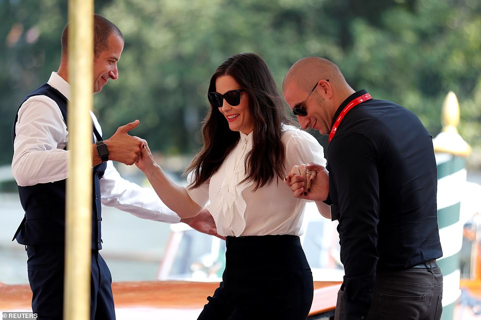 Helping hand: Rounding off her chic look, the daughter of Steven Tyler shielded her eyes from the sun in a pair of black cat-eye shades as she was helped off the vehicle by staff