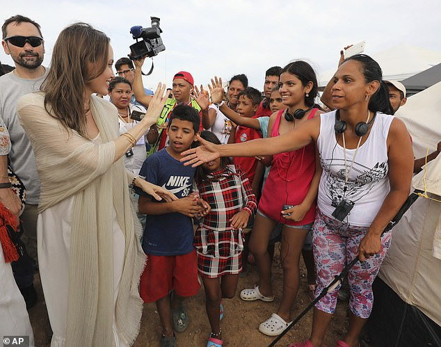 Paying it forward: Jolie began her tireless work on behalf of those displaced by conflict in 2001; she is pictured meeting Venezuelan migrants at a United Nations-run camp in Maicao, Colombia, on the border with Venezuela on June 8, 2019