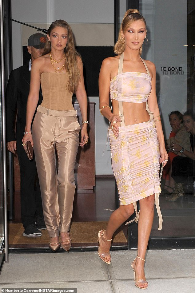 Time to go:Bella and Gigi, who are both set to present on stage at the show, were seen leaving their hotel together earlier on