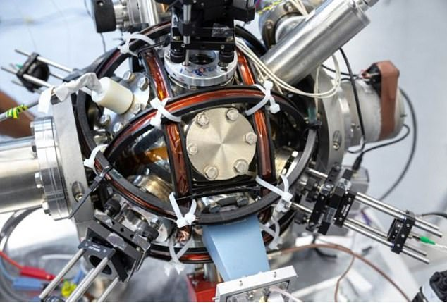 Scientists used a special chamber to monitor atoms as they interacted with a metal sphere positioned in the middle