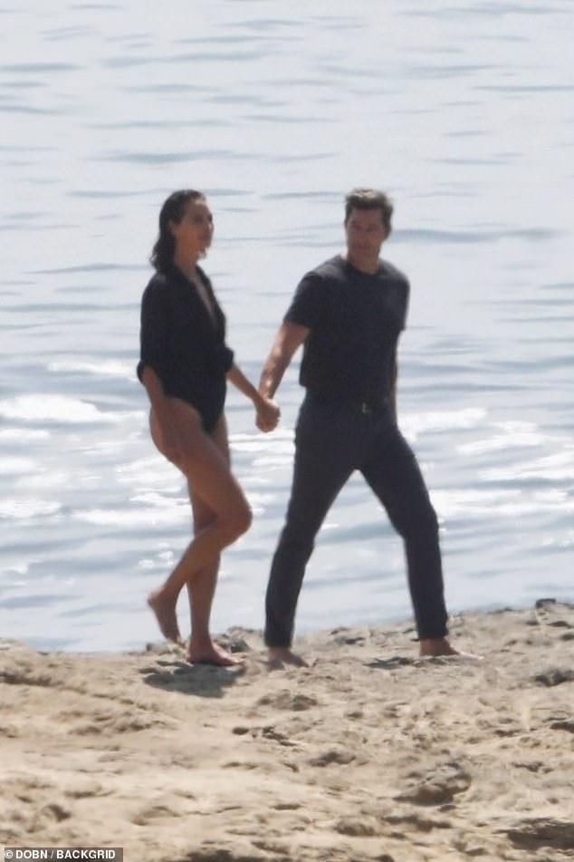 Scenic:The two enjoyed a romantic stroll down the shoreline as they walked hand-in-hand