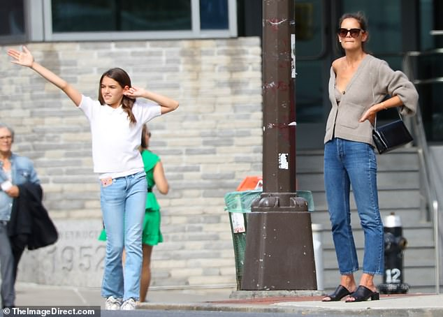 Like mother like daughter: The teenager seemed to be taking a note from her mother's style book, looking casually chic in a white collared blouse, jeans and white trainers