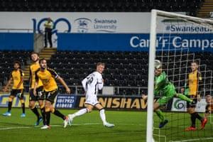 Sam Surridge bangs home to score Swansea City's third.