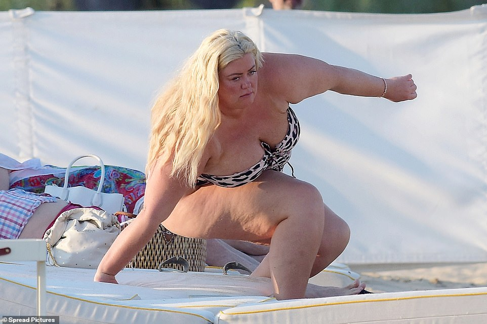 The former TOWIE star proved to be living her best life as she showed off her curves in a strapless leopard print swimsuit