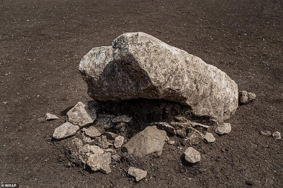 The monoliths and cairn, which may have had religious or spiritual significance for their builders, were deliberately knocked down - perhaps by a later culture with different beliefs, researchers say