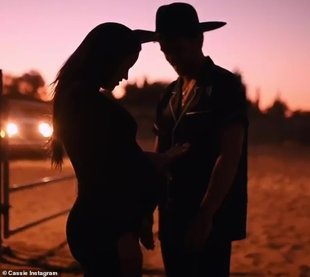 Mama-to-be: Cassie flaunted her burgeoning baby bump in the sweet video