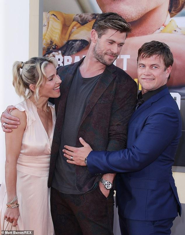 Tribute: Meanwhile, Westworld actor Luke Hemsworth (right) shared a lengthy tribute to his Thor star brother Chris (centre) on social media. They are pictured with Elsa Pataky (left) in July