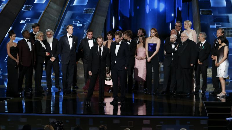 "Writers D.B. Weiss (L) and David Benioff, with cast and crew, accept the award for Outstanding Drama Series for HBO's ""Game of Thrones"" at the 67th Primetime Emmy Awards in Los Angeles, California September 20, 2015. REUTERS/Lucy Nicholson"