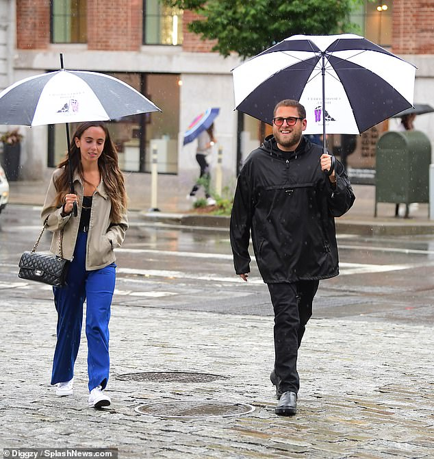 Getting married: Hill and Santos were spotted out and about in a rainy New York on Monday but look set to be settling down in sunny California