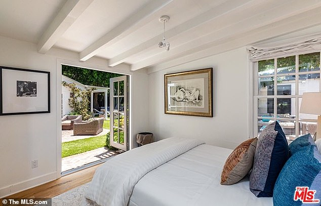 Country feel: The master suite is situated in its own private wing and has a wood floor and beamed ceilings