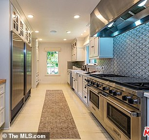There's a large recently remodeled kitchen with top of the range stainless steel appliances and custom cabinetry
