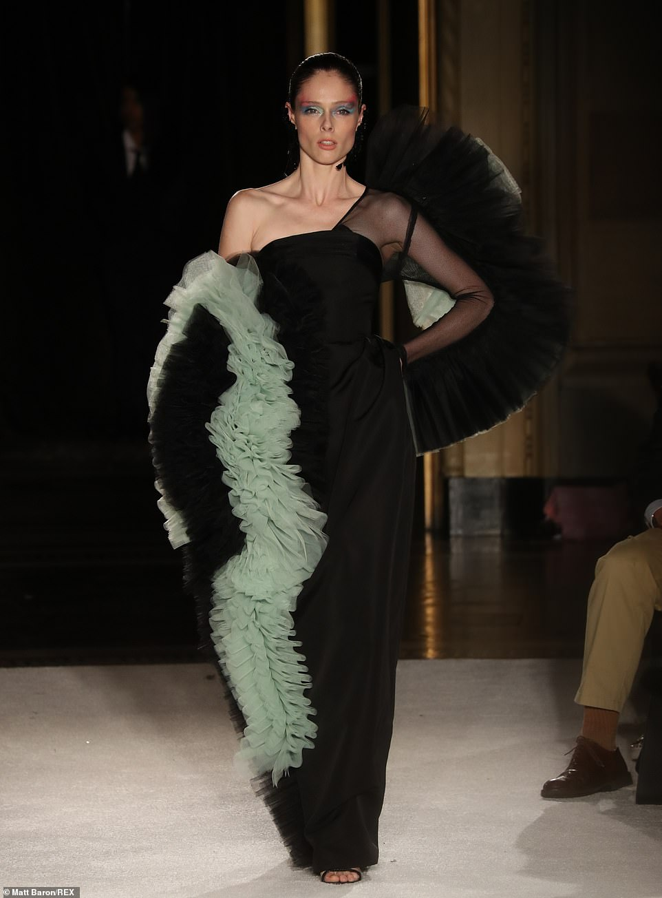 Flashy: Coco walked the runway in an incredibly eye-catching number with teal puffs