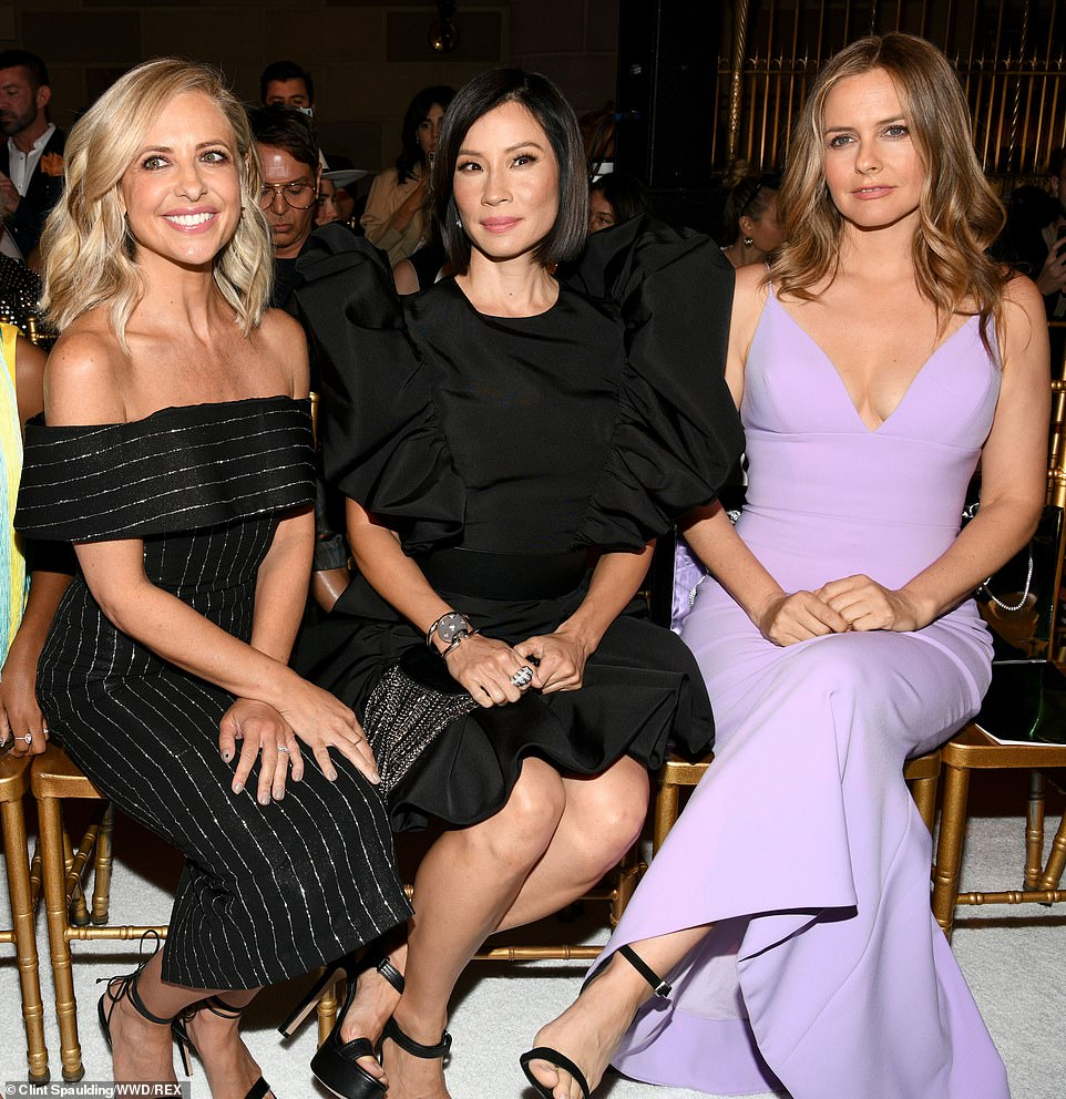 Sitting pretty! Sarah Michelle Gellar worked a black dress with silver stripes while Lucy Liu brought the drama in a puffy dress