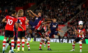 Nathan Ake heads downwards to score the opening goal at St Mary's.