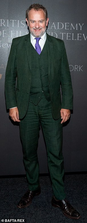 Dapper: Hugh Bonneville sported a dark green tweed suit with a matching vest