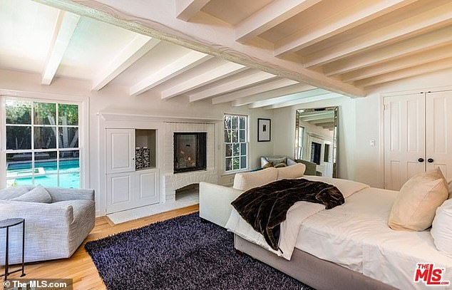 Plenty of room: The guest house includes a master suite with a fireplace, sauna and its own patio