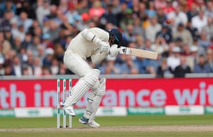 Stuart Broad reacts to a rising ball from Pat Cummins.