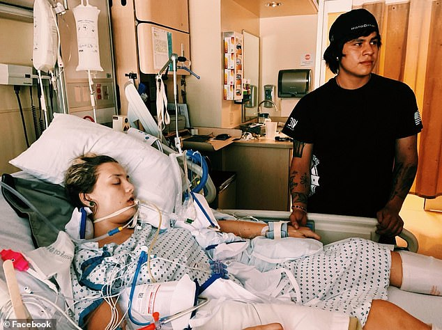 She was transferred to a different hospital where she was intubated and placed in a medically-induced coma. Pictured: Nelson in the hospital with her boyfriend