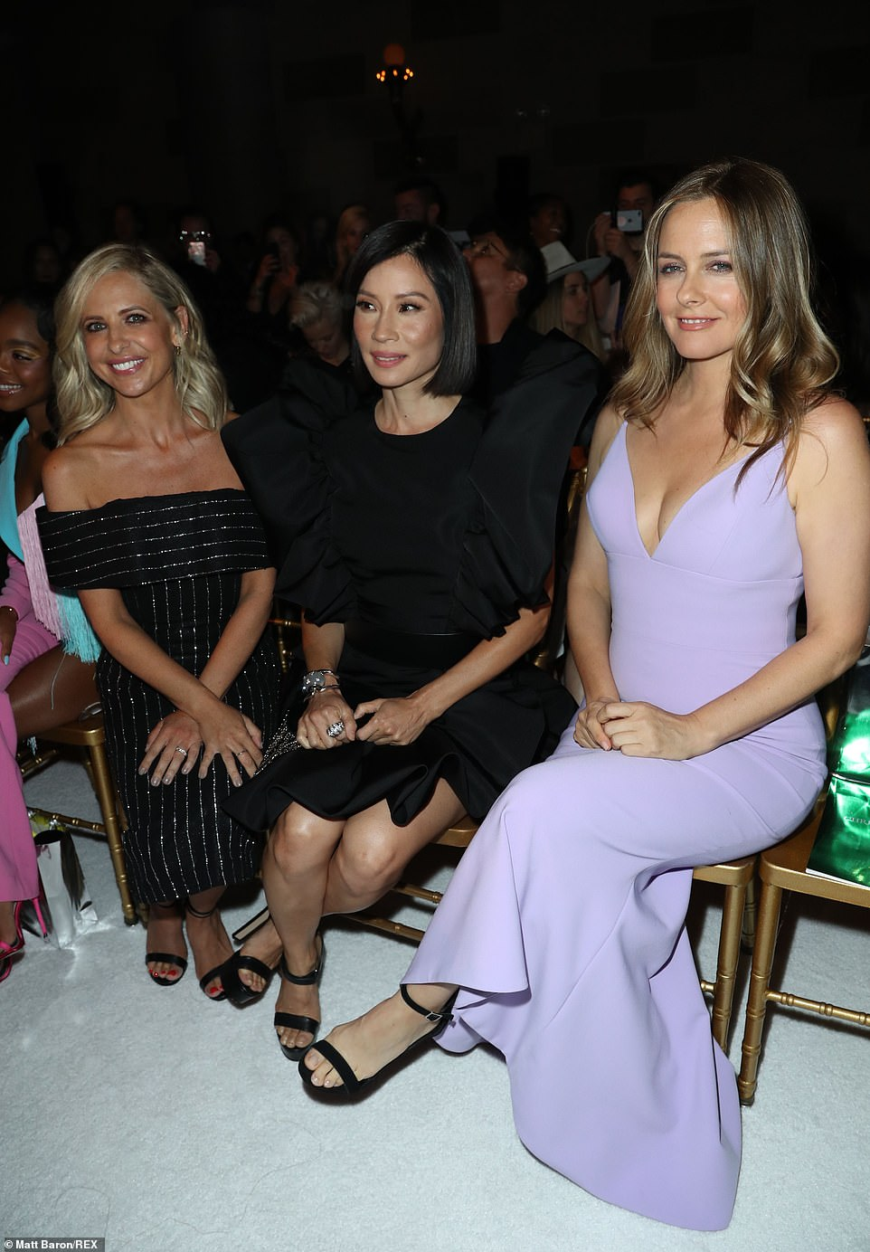 Star-studded: The ladies lit up the front row with their keen eye for style