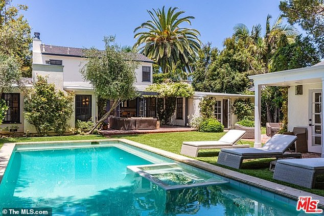 Room to roam: The two-story home with three bedrooms sits on just over a quarter acre with lush landscaping, a rectangular pool and a guest house