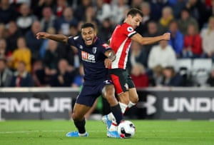 Joshua King goes down after a challenge by Cedric Soares.