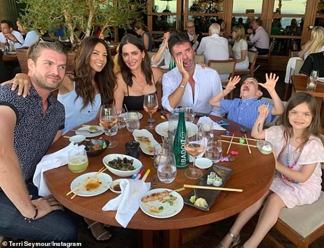 Pals:Simon celebrated his 60th with a small dinner with partner Lauren, son Eric, five, and ex and close friend Terri Seymour at Nobu in Malibu on his official birthday on Monday 7 October (Simon pictured with Lauren, centre, Terri, left, and son Eric, right, in August)