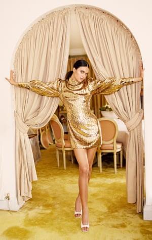A model in a gold Borgo De Nor mini dress and high heels