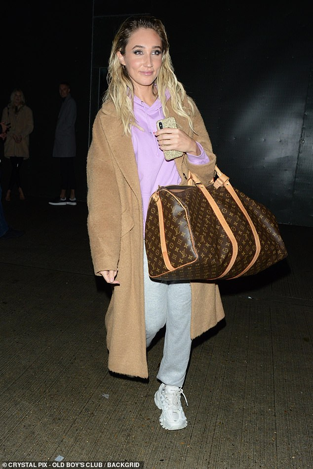 Style: The former TOWIE star cut a casual figure as she made her way home after the show, donning a pink hoodie and grey tracksuit bottoms