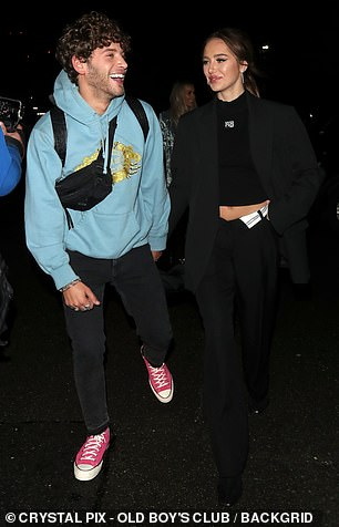 Couple: Eyal Booker, 24, looked on cloud nine as he left the studio with his girlfriend Deliliah Belle Hamlin