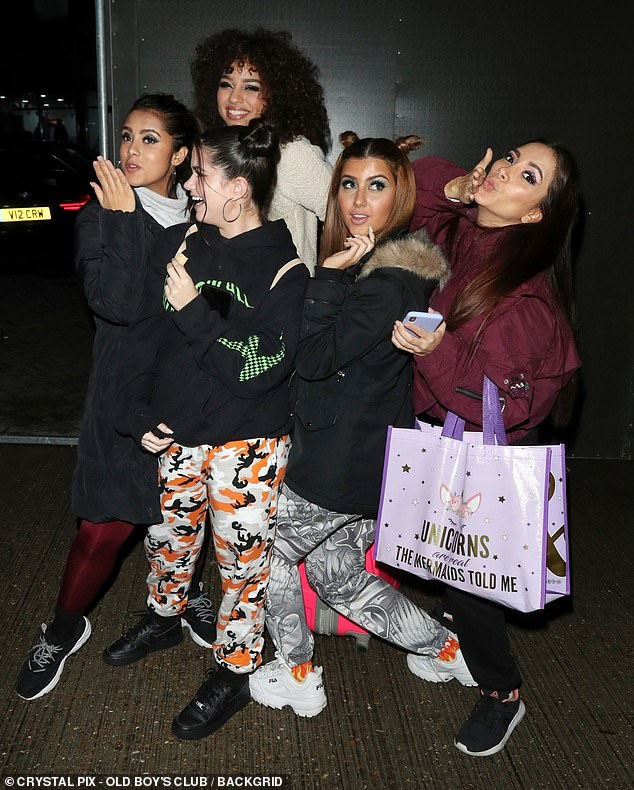 Fun: Girl group V5 posed for a playful snap outside after their performance
