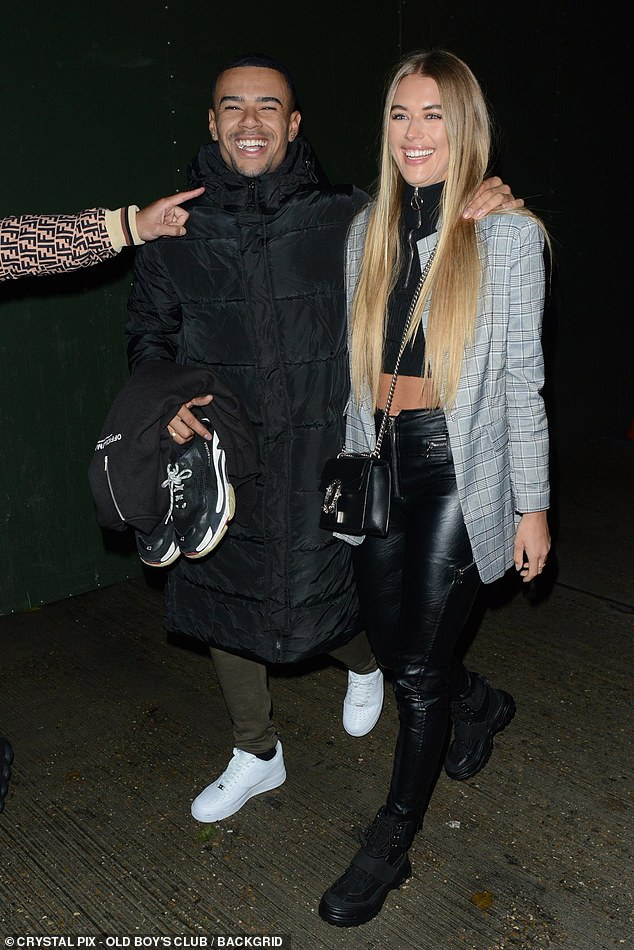Glam: Arabella looked stylish in a black crop top with leather trousers and a check blazer