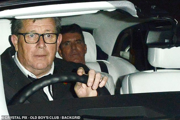 Low profile: Simon Cowell, 60, was spotted making his departure in the back of a car