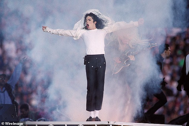 In the zone: While there are no other details of the biopic, John Logan has been asked to write the script for the movie. The singer is pictured above during his halftime show in 1993 after a wardrobe change