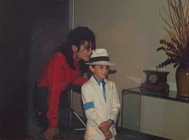 Documentary: Michael is pictured above taking a picture with Wade Robson in the documentary Leaving Neverland
