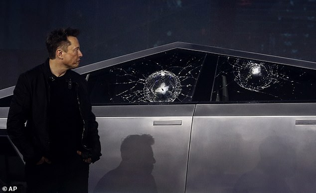 On a Los Angeles-area stage with Musk (pictured), Tesla design chief Franz von Holzhausen hurled a softball-sized metal ball at the driver's side window to demonstrate the strength of the glass, which Musk called 'Transparent Metal Glass.' It shattered
