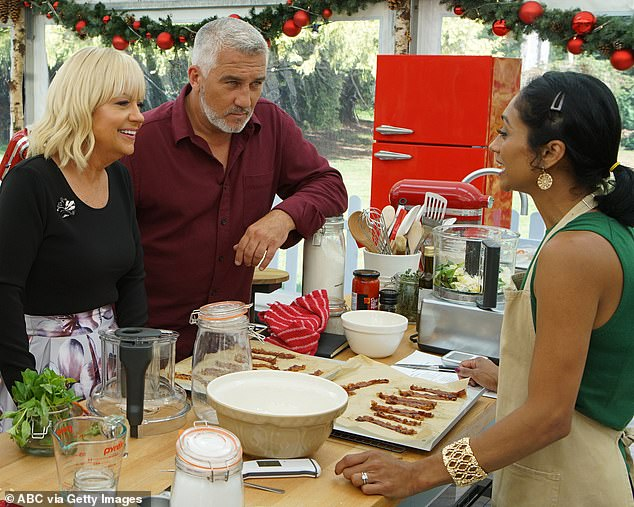 Menacing: As ever Paul appears to be a tough critic as he judges the baking creations in the festive creations
