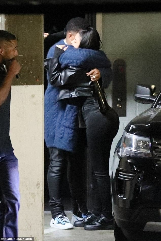 Keeping it simple: Kylie opted for a sombre and sophisticated look, donning figure-hugging black jeans