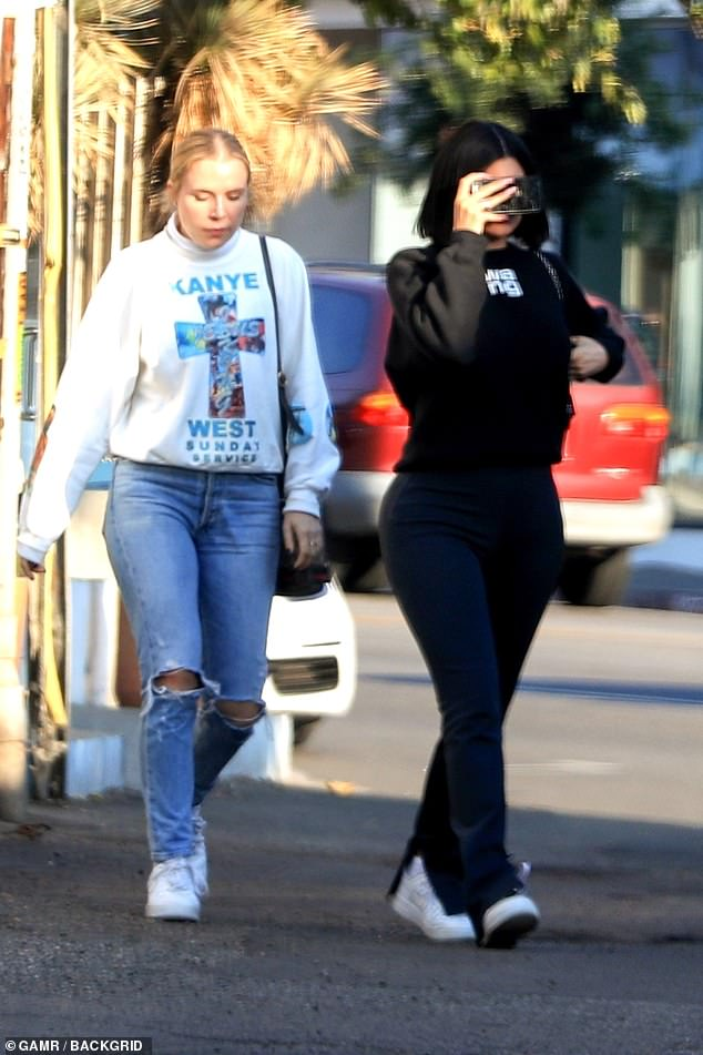 Family ties: Kylie's friendwas rocking a sweater from Kylie's brother-in-law Kanye West's Sunday Service merchandise line