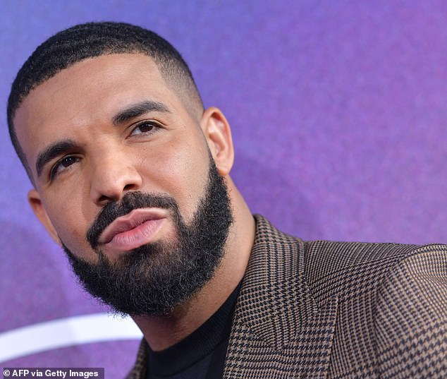 Hot for her:Kylie's outing comes amid claims Drake has set his sights on the star, with a source claiming to Us Weekly that the Canadian star 'has always had a thing for Kylie and it's mutual'