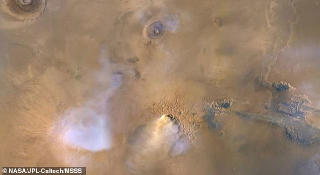 New research shows that giant dust towers that form during planet-wide storms on Mars might have helped drain the planet's surface stores of water
