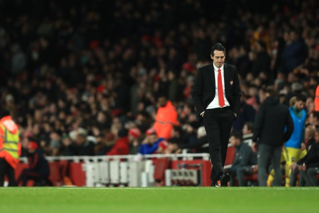 Arsenal boss Unai Emery looks dejected with his hands in his pockets as he walks the touchline