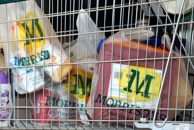 Plastic bags sit in a shopping trolley at a Morrisons