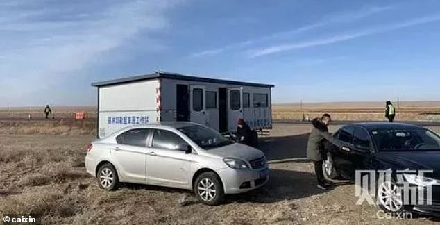 Four plague cases in China have prompt the government to stop and search traffic for signs of a high temperature. Pictured, a temperature checkpoint is set up along the provincial highway 101 from Sunit Zuoqi to Xilinguole League
