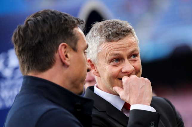 Former Manchester United team-mates Gary Neville and Ole Gunnar Solskjaer in conversation at the Nou Camp