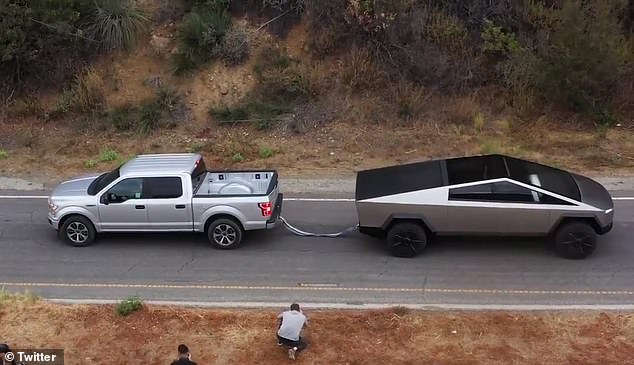 The billionaire also shared that the Cybertruck is a 'better truck than an F-150' and included a video of the two vehicles in a game of tug of war – with Telsa's truck beating the competition