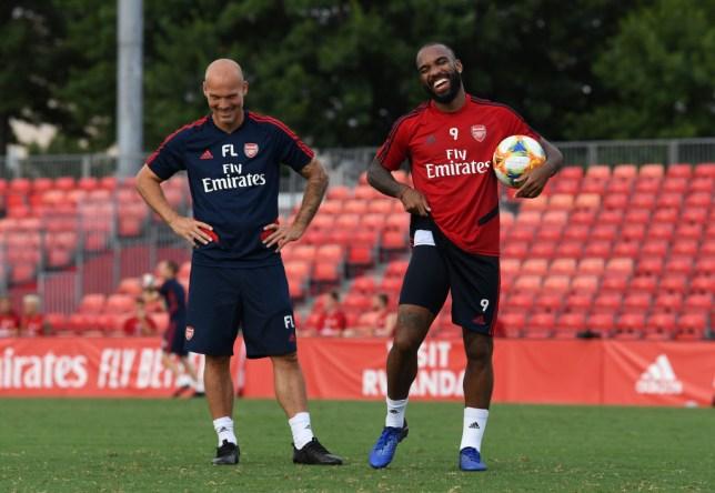 Freddie Ljungberg and Alexandre Lacazette laugh during Arsenal training