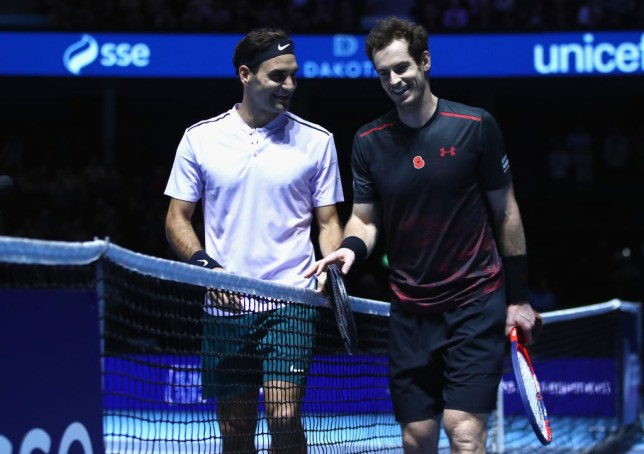 Roger Federer chats to Andy Murray during a charity match