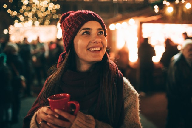 Woman drinking mulled wine at a Christmas market