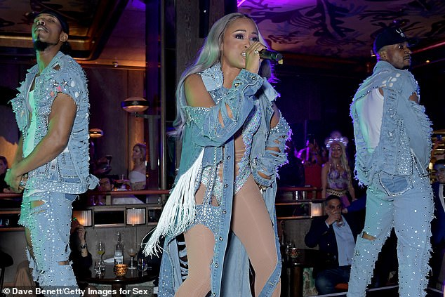 Backup: The Gangsta Lovin' singer pounded the stage alongside two male dancers who wore outfits imitating the jazzed up denim worn by Eve